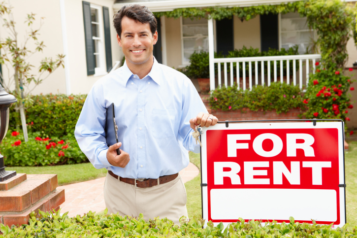 image of man in front of house for rent