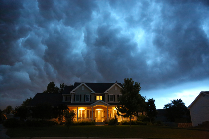 image of house with storm clouds behind it