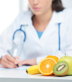 image of doctor with fruit in front of her