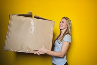 image of girl carrying box
