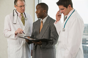 image of doctors talking with business man