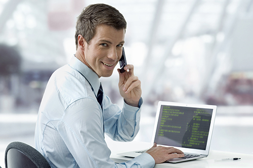 image of man working and talking on phone
